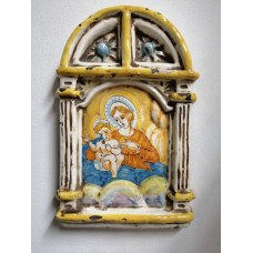 Hand-painted ceramic altarpiece depicting Madonna with child.